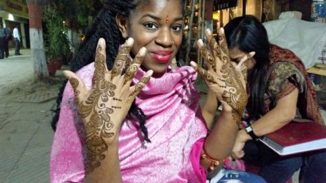 Getting some mehndi (henna) done on the streets on Delhi