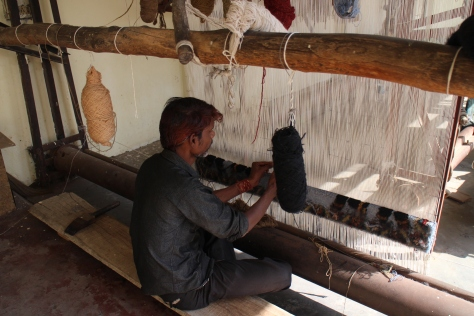 Textile factory - This guy was hand-weaving carpets and he was going SO fast. John Lewis retails some of the carpets made in this factory.